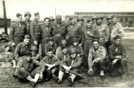 My grandfather, Frank Van Kerckhove (kneeling, 2nd from right), with his own band of brothers. He trained for the Pacific, but remained States-side working the Signal Corp and weapons inspection.